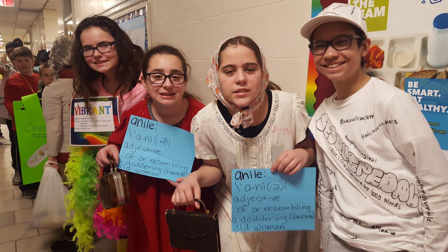 Sixth graders get into the spirit of the Vocabulary Parade. It's their last year in the parade, so they wanted it to be memorable. Some students chose a funny word while others went for a word with the most letters.