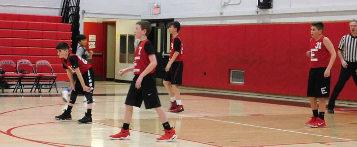 The 12U travel basketball team plays a tough defensive. They practice their skills every Wednesday. Players form a brick wall and stop almost anyone on offense.