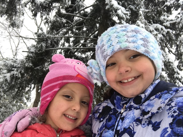 Some children in Emerson made the most of the day off from school by playing in the snow. The flakes fell fast and furiously late afternoon and clung to area trees and pines. Sunny skies the next day melted the scene, however.