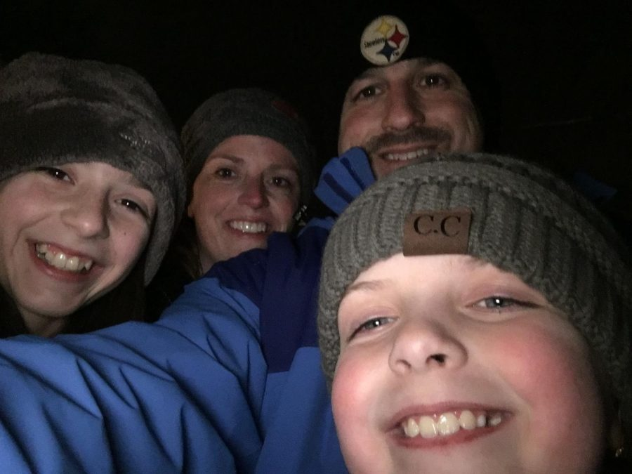 Some families bundled up and headed outside to enjoy the snoy weather together. The cold air didn't stop this family portrait.