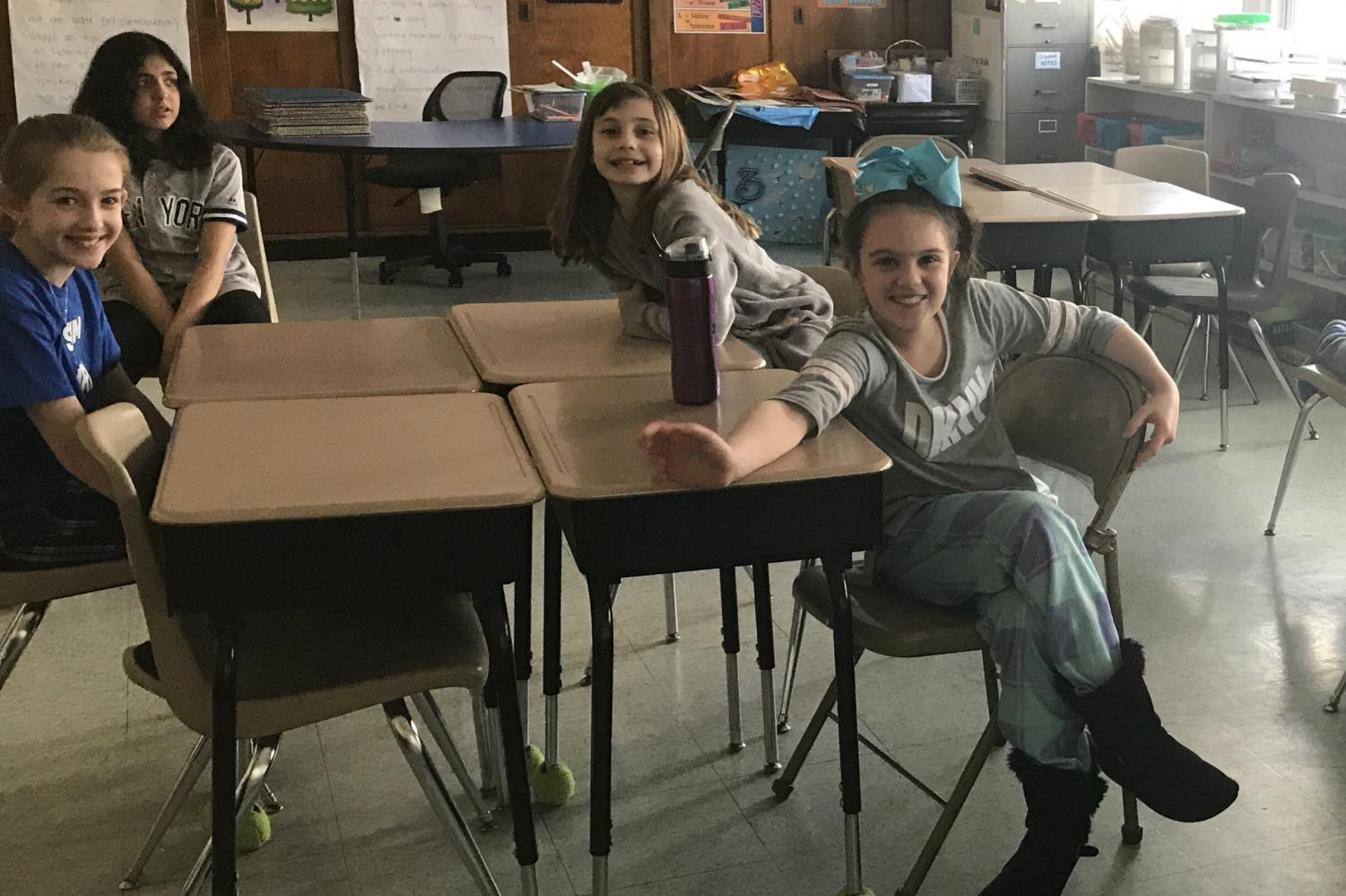 The family of sixth grade math teacher Mrs. Leigh Martin is very excited to participate in this month's activity. This family calls themselves the Ferocious Ferrets. All the famlies created fun names for themselves at their first meeting.