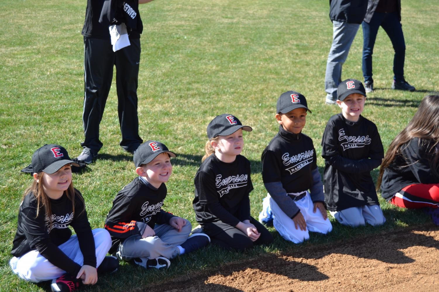here a group of kindergartners on the T-Ball team sit and listen enthusiastically to the announcements of the season. This is one of dozens of teams from the borough. Children from kindergarten through eighth grade play baseball or softball.
