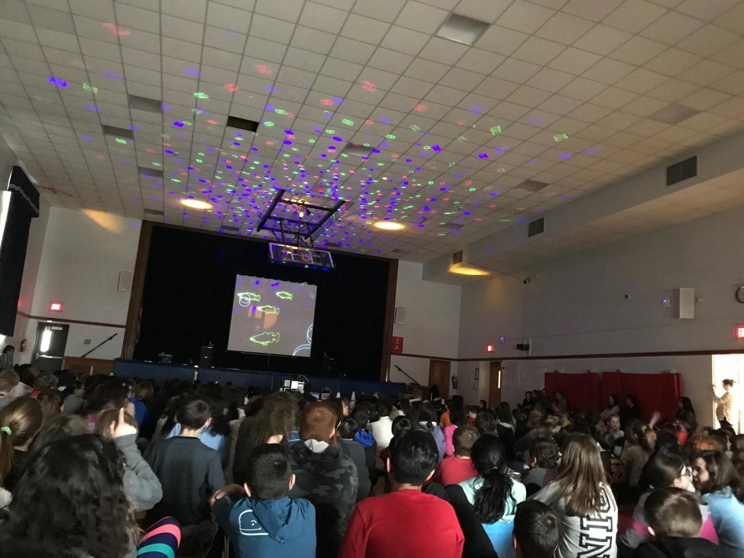 Students at Patrick M. Villano School enjoy the laser light show. This year, the message was about integrity.