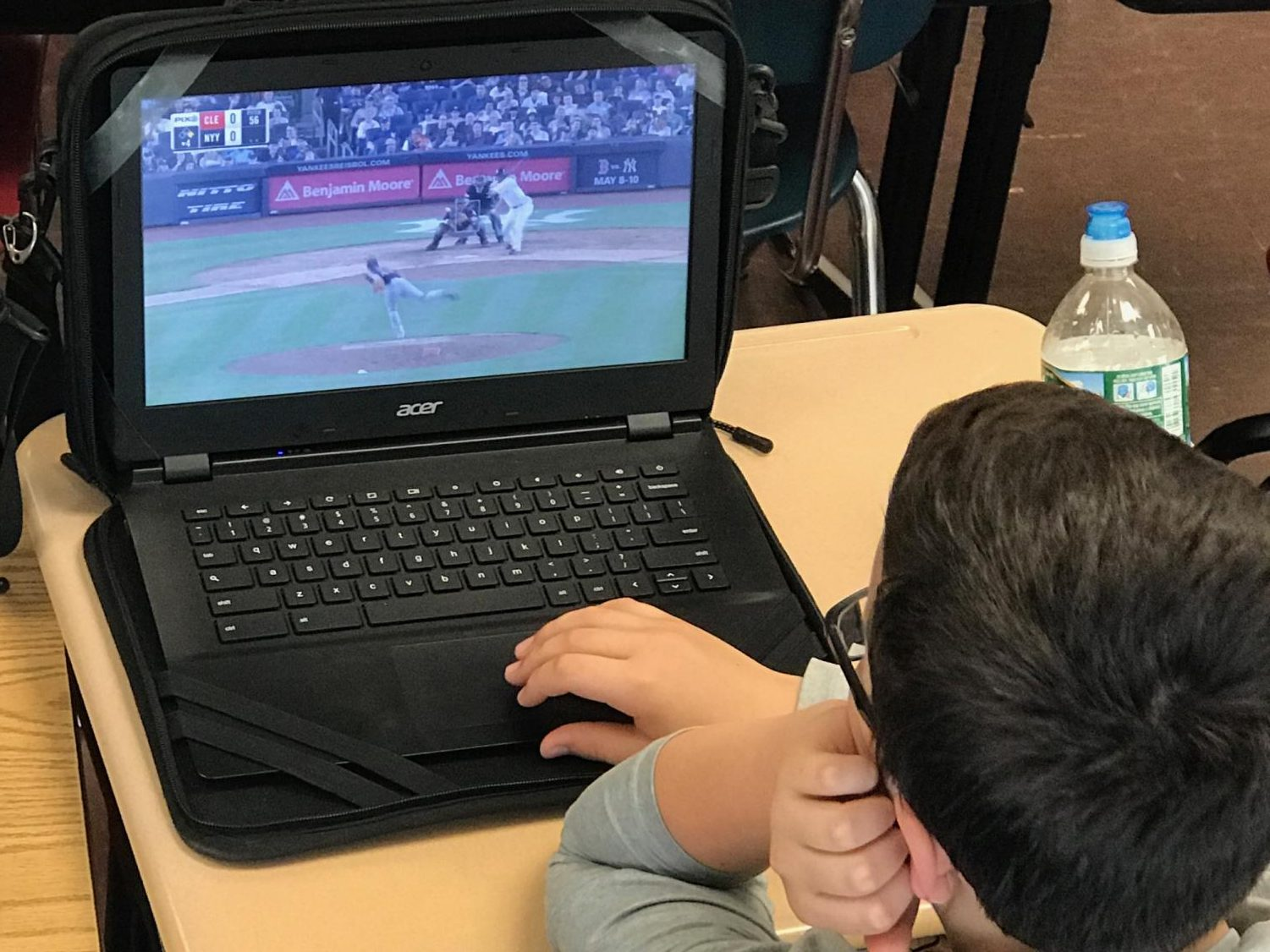 Sixth grade student, Patrick Walsh, watches Yankees highlights on his laptop. The Yankees have hit 79 home runs this season - an impressive start for this early in the regular season.