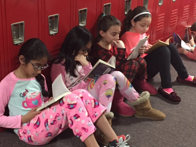 Students in grades three through six line the hallways on the last Friday of each month for the Great Hallway Read. This is a special half hour of time where students can be alone with their favorite book.