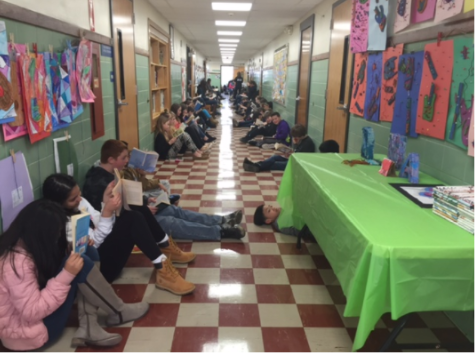 Students+focus+on+their+books+in+the+sixth+grade+hallway+of+Patrick+M.+Villano+School.+Heads+are+down%2C+as+students+read+their+novels.+This+is+the+scene+in+every+hallway+during+the+Great+Hallway+Read.