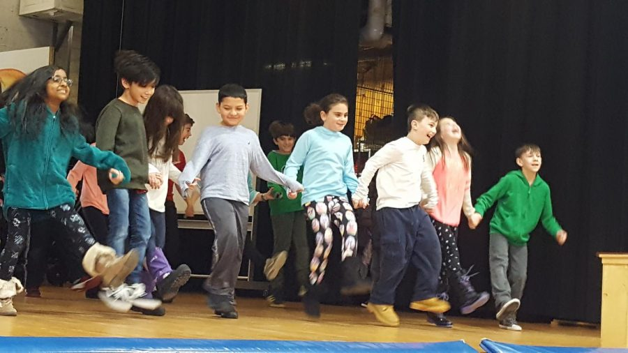 Culture is also displayed through different songs, dances and music. Students perform on stage.