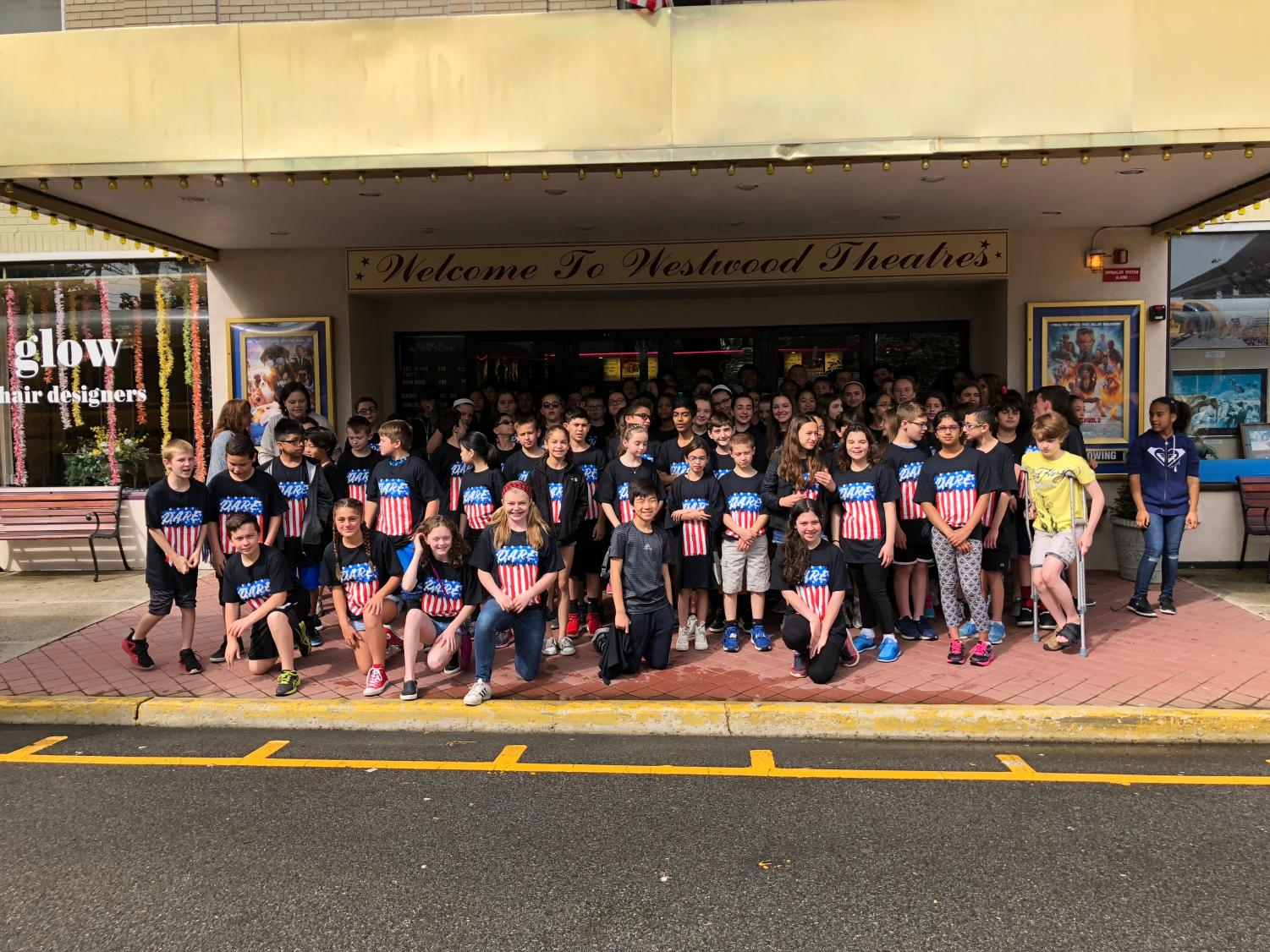 Sixth graders attend a movie at the theater in Westwood, NJ, as their final D.A.R.E. activity. Each students is wearing a special D.A.R.E. t-shirt.