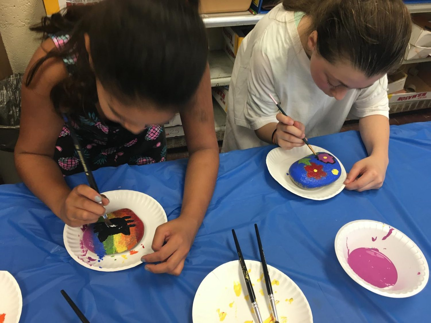 Students in grades 3 through 6 painted rocks after hearing the book Only One You by Linda Kranz. Each rock shows the student's individuality. The rocks will be cemented into a rock garden later this school year.