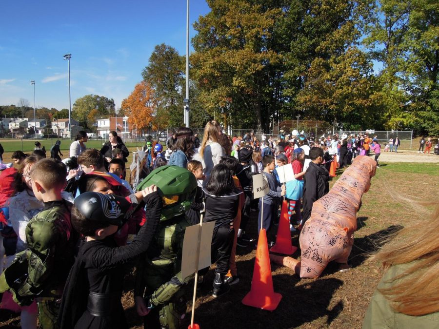 All the students of Villano school and Memorial schools wait patiently here for the parade to start. Students stay with their homeroom teacher and take two trips around the lower field to show off their costumes.