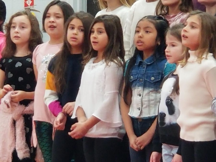 At this dress rehearsal for the Winter Concert, third and fourth grade students in the chorus sang thier songs. The dress rehearsal is designed to help students perfect their performance.
