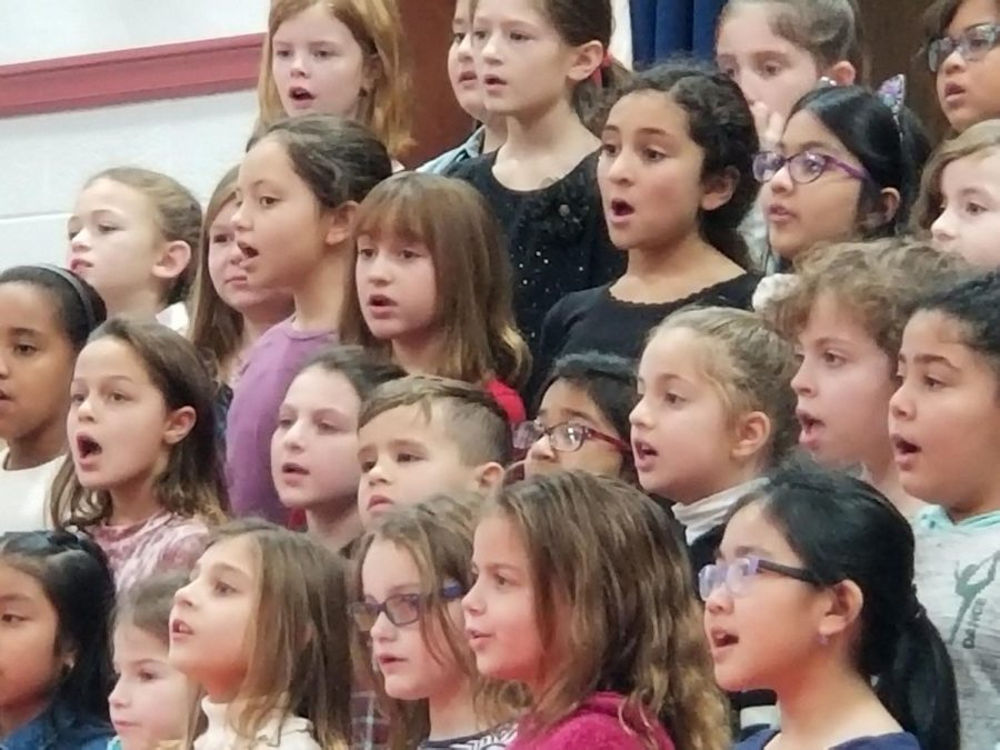 Students start practicing early in the school year for the Winter Concert. These third and fourth grade chorus members sang
