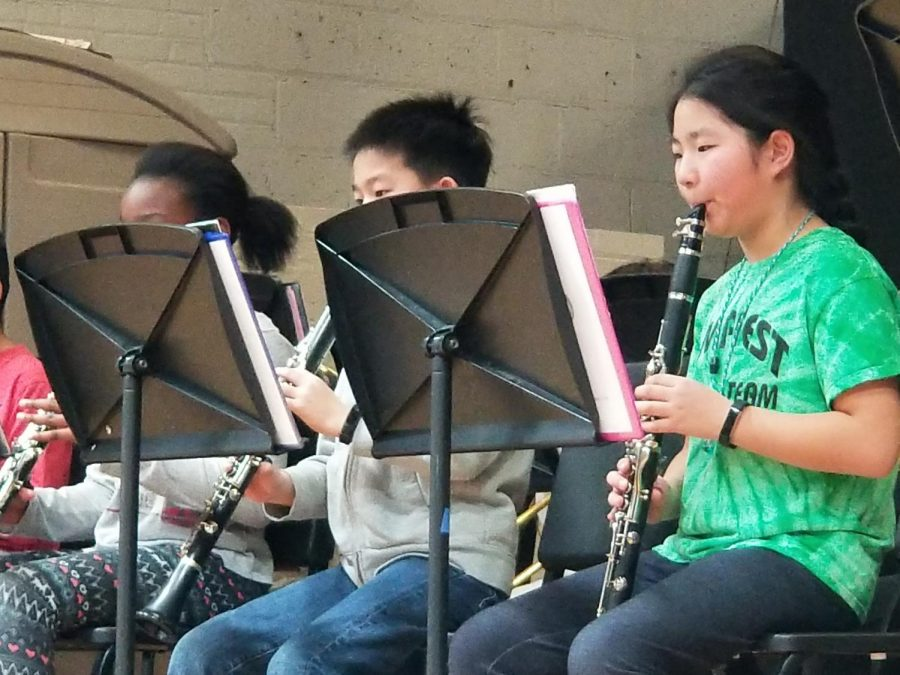 The Concert band took the stage for their first concert of the school year. These students are playing the clarinet, a woodwind instrument.