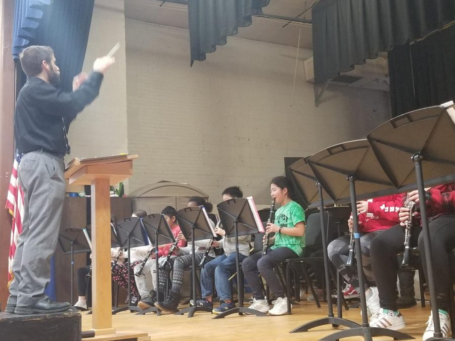Andre Baruch is the band director at Patrick M. Villano School. Here he is instructing the Concert band.