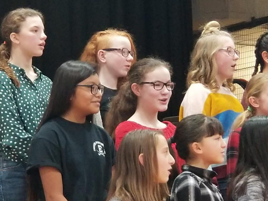 The fifth and sixth grade chorus members practiced often during music class and before school hours. Many looked forward to the evening performance when family members attend in the audience.