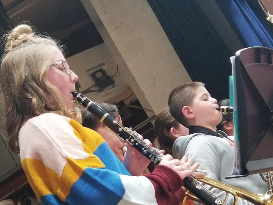 This group of fifth grade students is playing Old Joe Clark which is an American folk song. They practicied this song independently during early morning band rehearsals.