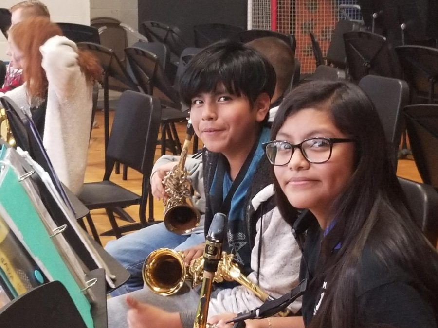 These two saxophone players are in the Symphonic band. That band is reserved for students who achieved certain lessons and can play more difficult concepts nad more challenging music.