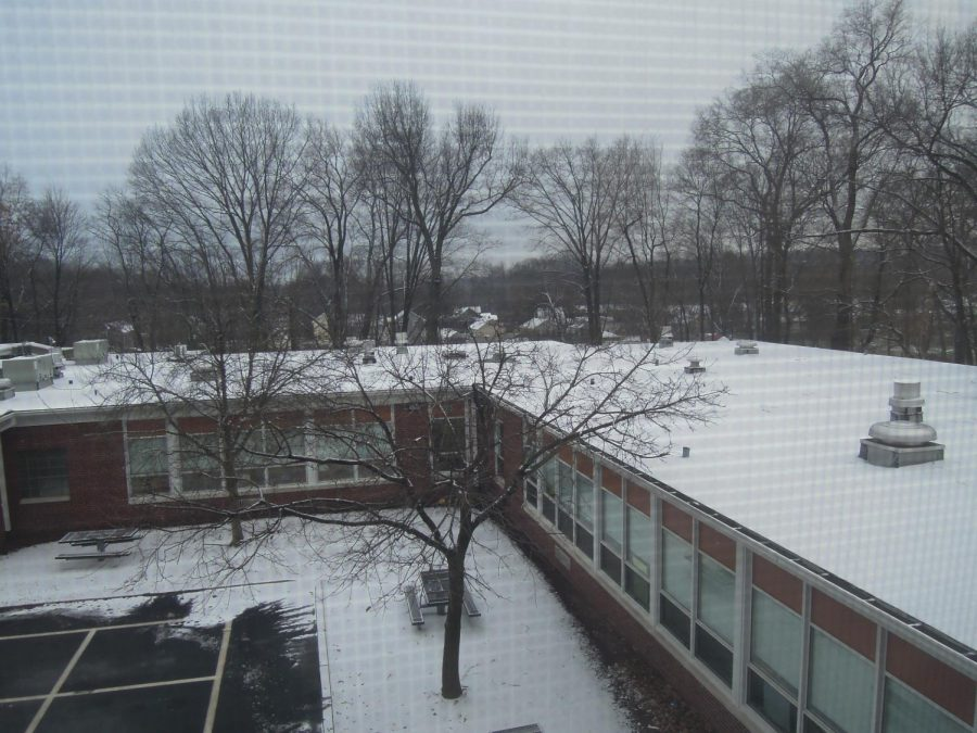 A+light+snow+covered+the+roof+of+Patrick+M.+Villano+School.+
