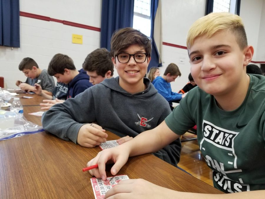 Students from different homeroom all gather in the all-purpose room for holiday parties in sixth grade. Aside from eating ice cream, students played Bingo for fun.