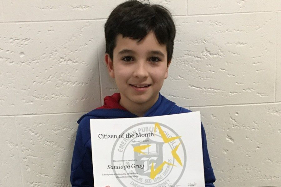 Third-grader  Santiago Gray won the Citizen of the Month award in January. He beams proudly holding his certificate.