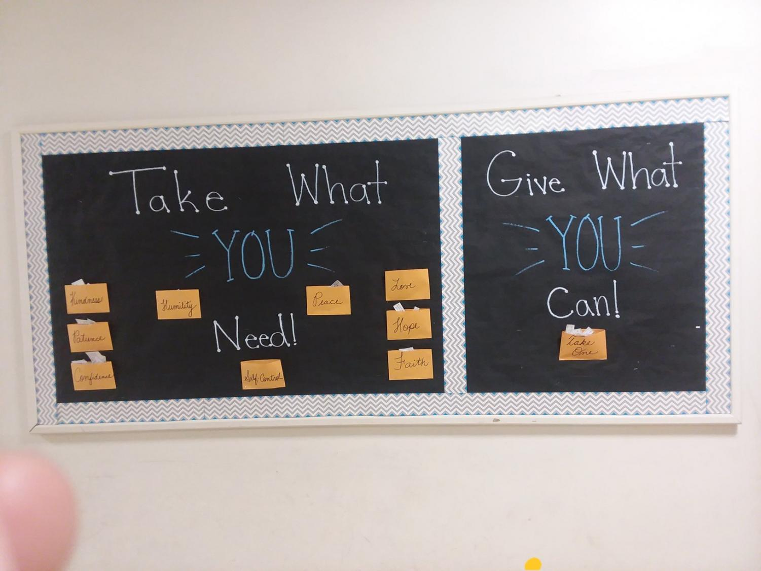 The new bulletin board in the main hallway of school is divided into two parts. On one side, students are asked to take what they need, and on the other, to give what they can.