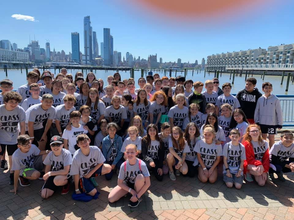 Sixth graders gather before boarding the Spirit of New Jersey boat for a class photo. The boat ride along the Hudson River is the annual end-of-year field trip for the grade.