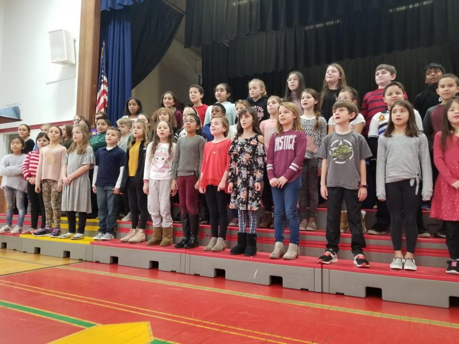 Third and fourth grade chorus started the Winter Concert with the holiday favorite