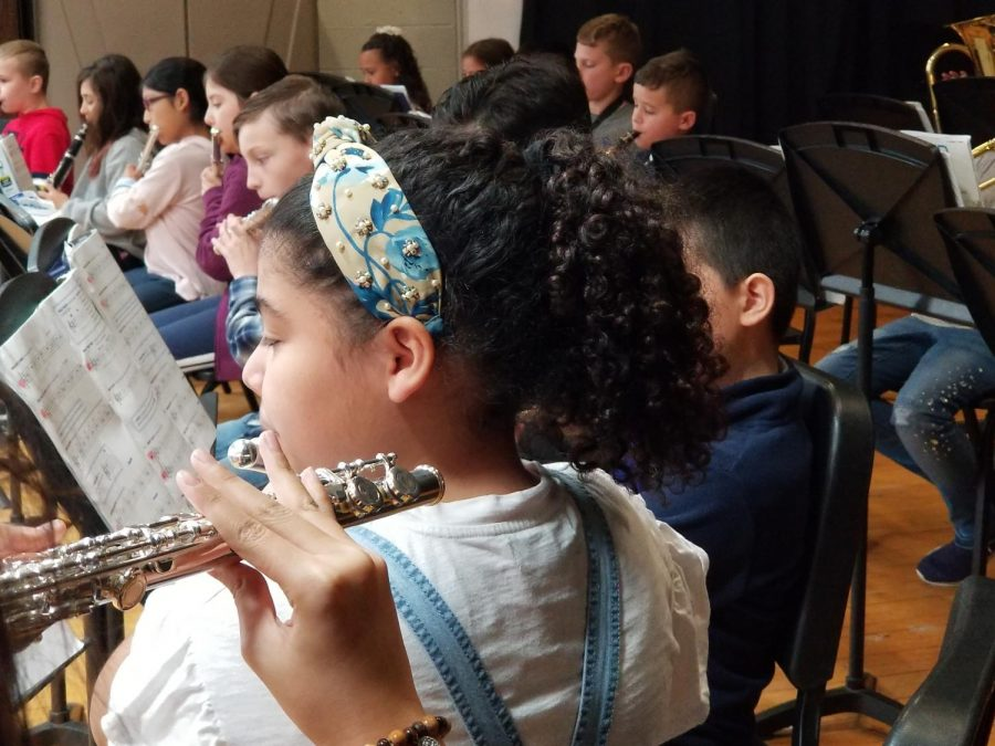 Students in beginner band played four songs including
