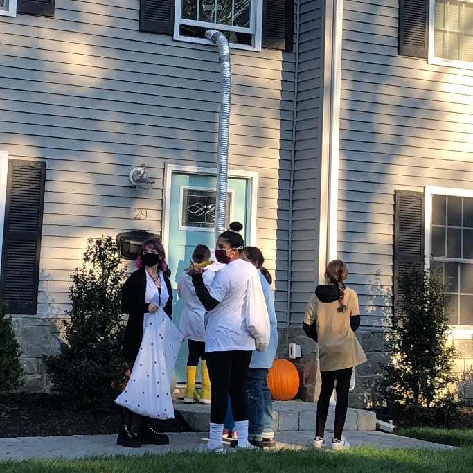 Some residents of Emerson found creative ways to give candy to trick-or-treaters. These homeowners created a chute from a second floor window that dropped treats to children waiting at the door.